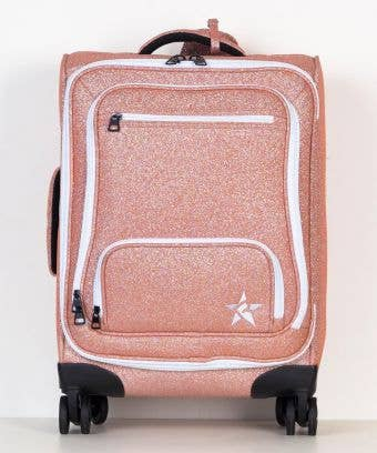 rose gold luggage with white zipper